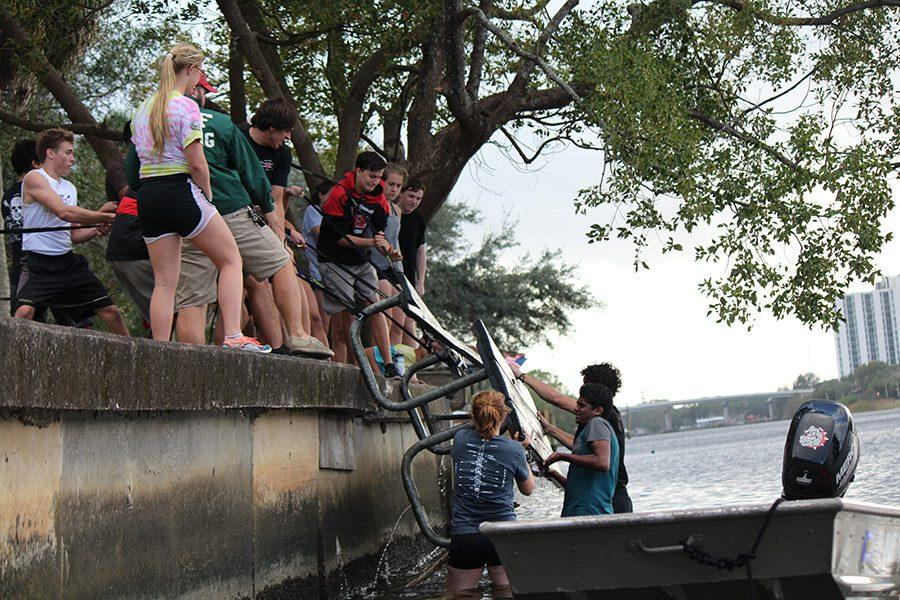 Crew team fishes picnic table out of Hillsborough River