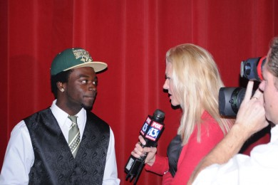 Nigel Harris interviews with Fox 13 after signing his scholarship.