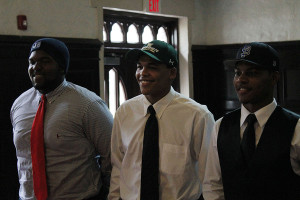 The signees all stand together after finalizing their signings.