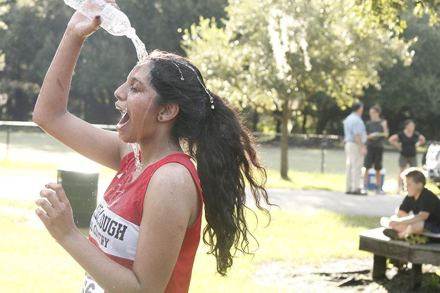Junior Shani Abraham cools off with an icy water bottle after a meet at Al Lopez Park .