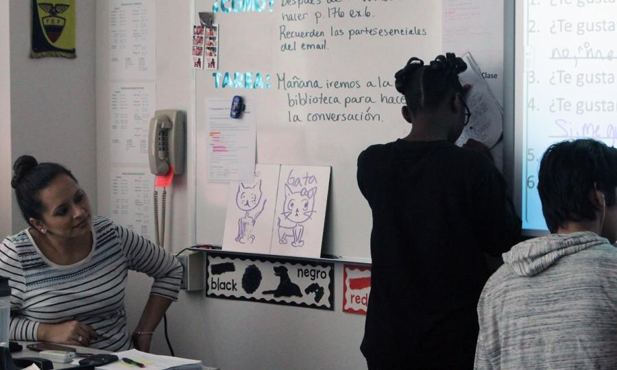 Spanish teacher Maria Gonzalez supervises while her students work out practice problems on the board. This week, she was named a finalist for district teacher of the year.