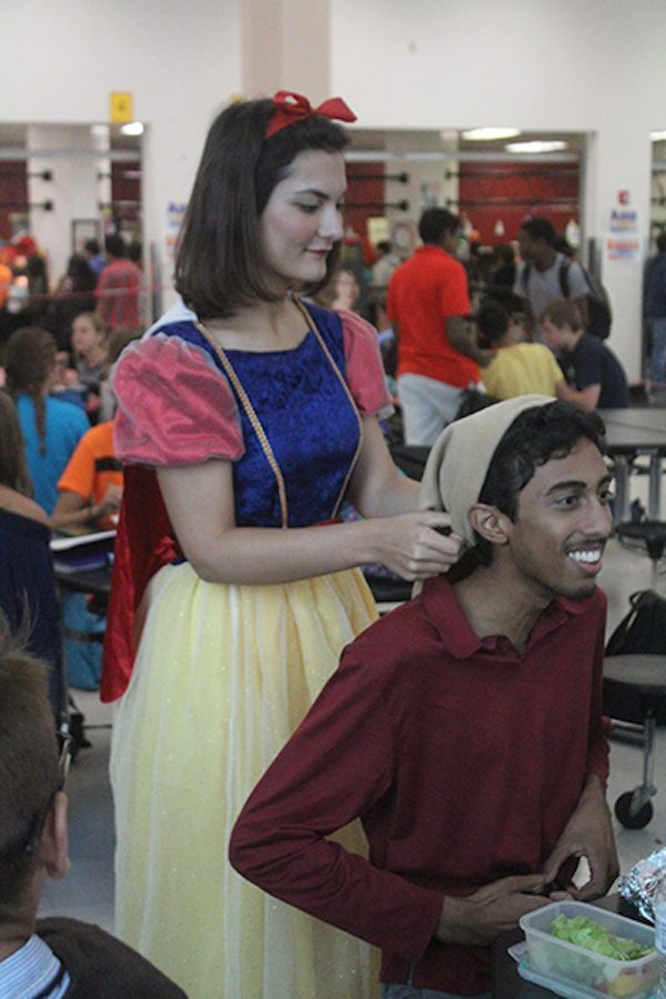 Seniors Cameron Fishback and Saajan Patel dress as Snow White and the Seven Dwarfs for character day.