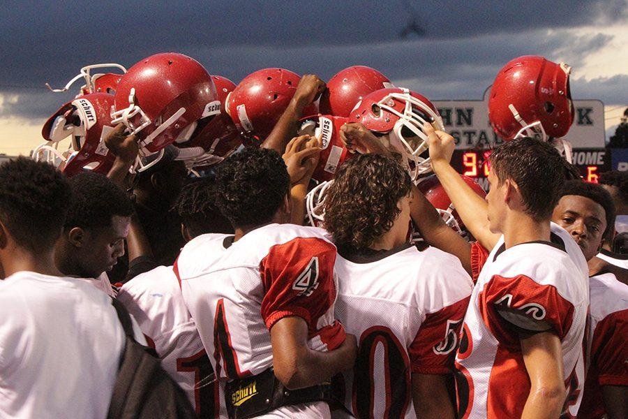 The JV team congregates during their game on Sept. 9.