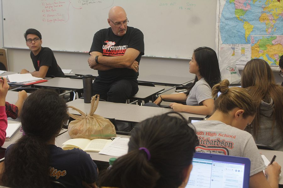 History, economics and then Theory of Knowledge teacher Tom Paloumpis speaks to senior Angela Yen, who was in his study hall-turned-TOK class. Paloumpis is one of five teachers who temporarily took on TOK classes.