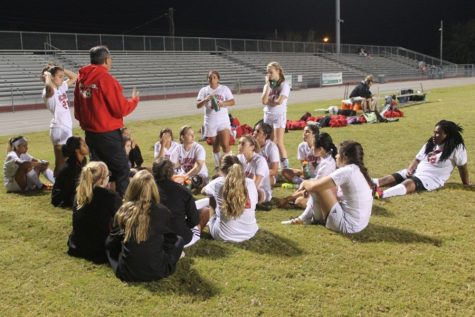 Head coach Ted Pamplona holds a meeting with the team after their first win of the season.