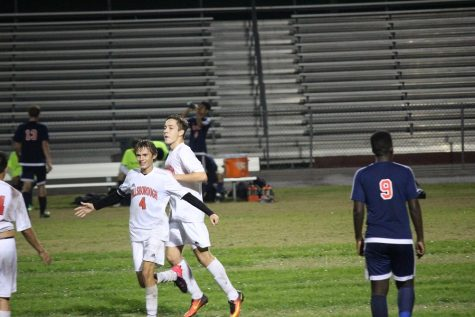 Junior Greyson Young celebrates one of his two goals in the game (Photo by Matt Lutton).