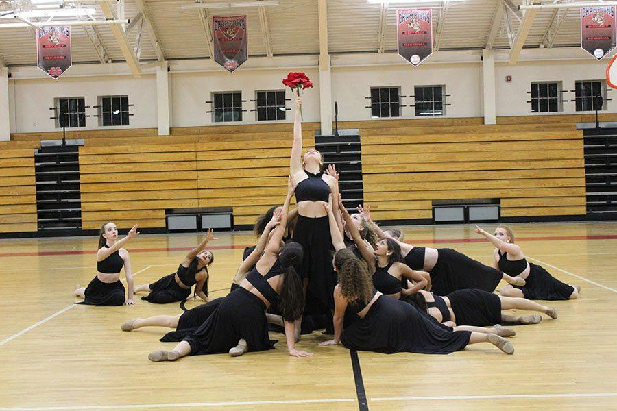 Senior Liz Linton holds the rose high in the final pose of the contemporary piece