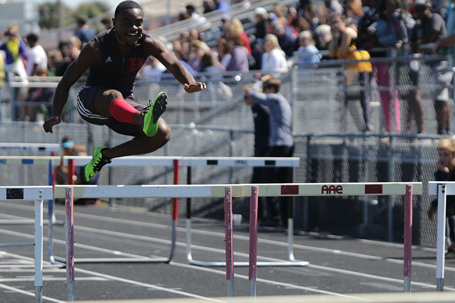 With a smile on his face, CJ Williams cleanly jumps a hurdle during the shuttle hurdle relay race.