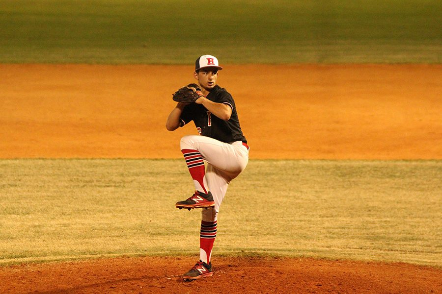 Pitcher Patrick Puentes strives to strike out his at-bat opponent