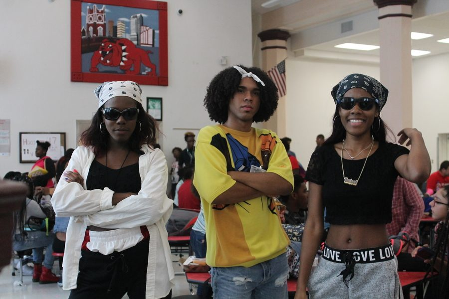 A group of seniors dress to represent the late 90s and early 2000s, dressing as Fat Albert and Aaliyah.  From left to right: Christine Robinson, Emanuel Perez, and Desiree Barton.