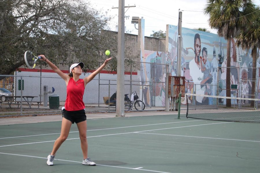 Nguyen serving the ball to her opponent during a singles match.