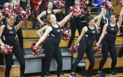 Cheerleaders, dance empowerment and band perform at pep rally