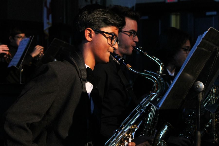 Freshman Abhay Satyajit and senior Albert Perez participate in their first performance of the night,