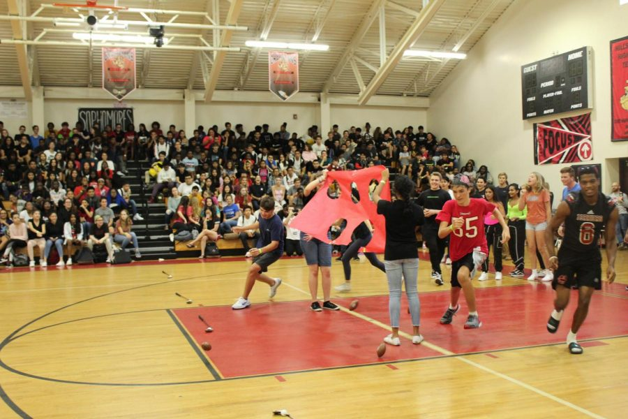 Fall sports teams compete in relay races during the pep rally.