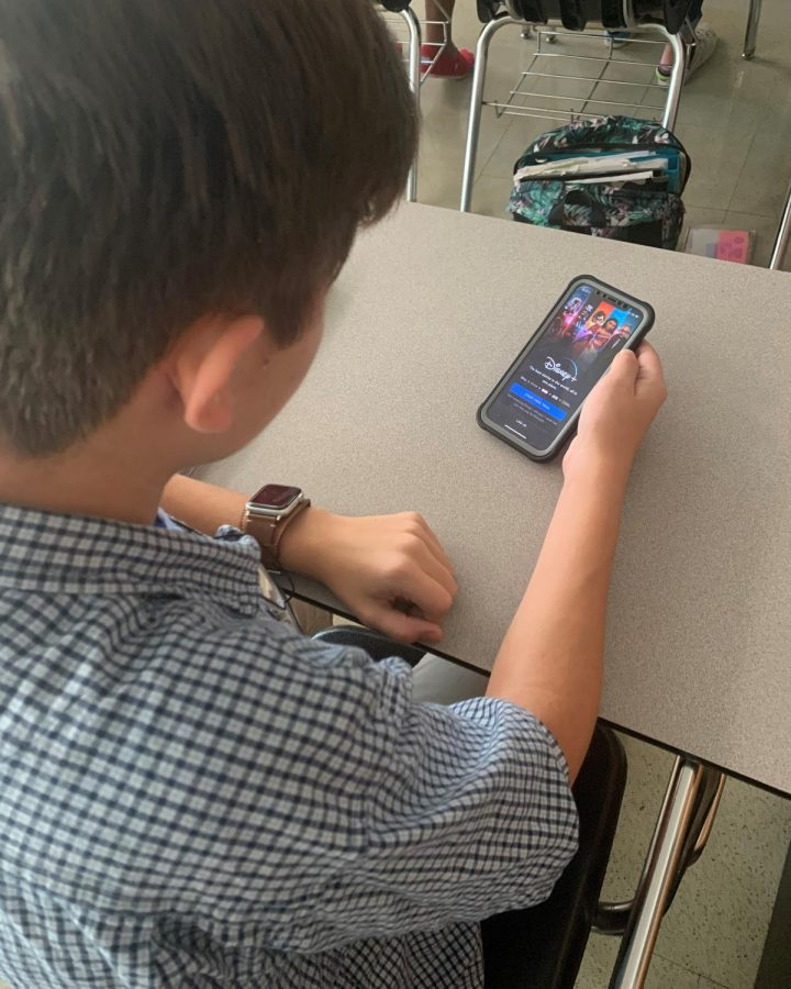 Freshman Anthony Aguilar uses the new Disney+ app that is available to download on any app store.
