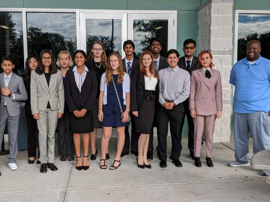The Speech and Debate team poses for a photo.