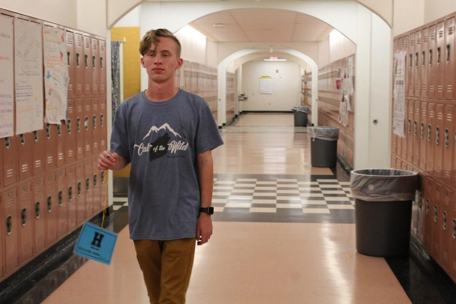Sophomore Zachary Ashcraft walks to the bathroom with a pass during a hall sweep.