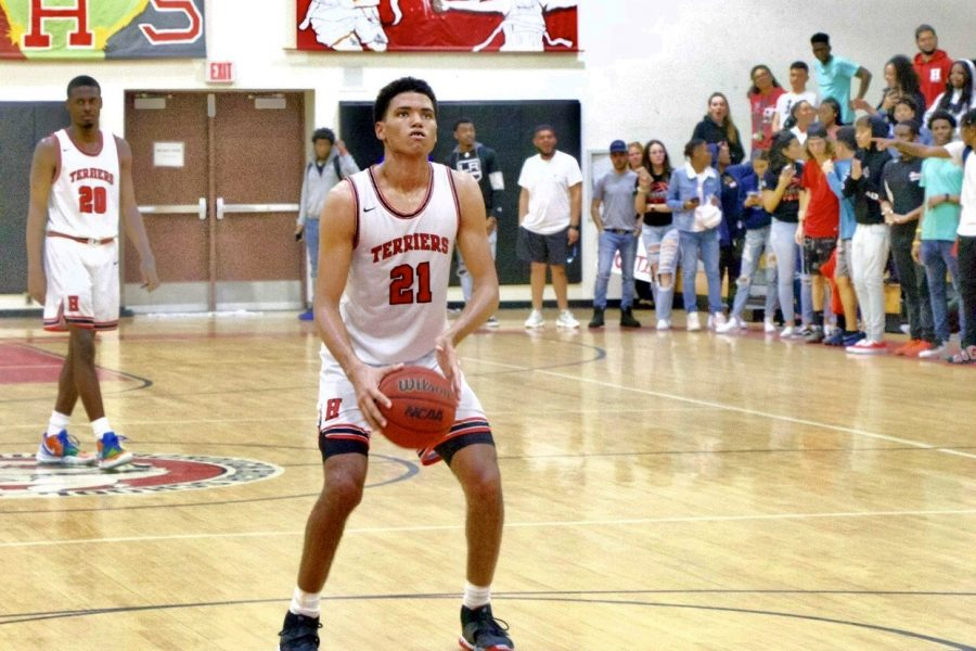 Senior Cantia Rahming prepares to take a free throw. He made the shot and the crowd began cheering for him.