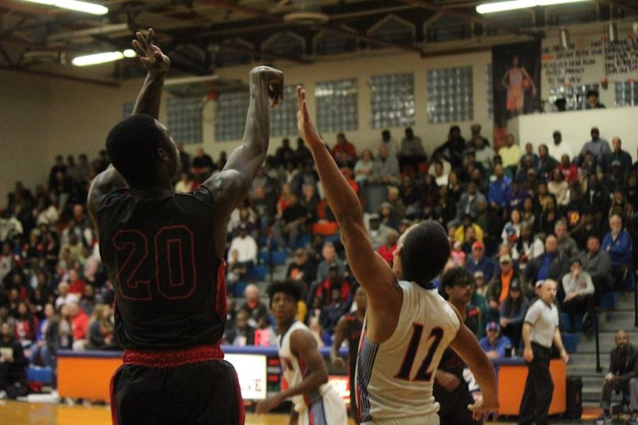 Senior Tyriq James shoots a three pointer in his opponent's face. The seniors will be missed by the younger players.
