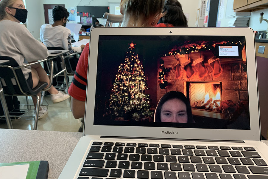 Junior Savannah Keaton customizes her background on Zoom to a fun Christmas theme